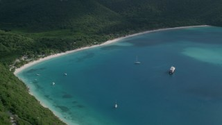 AX102_284 - 5k stock footage aerial video of White sand Caribbean beach surrounded by trees and turquoise blue waters, Magens Bay, St Thomas