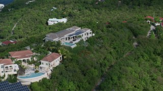 AX102_285 - 5k stock footage aerial video of Hilltop mansions looking out toward sapphire blue Caribbean waters, Magens Bay, St Thomas