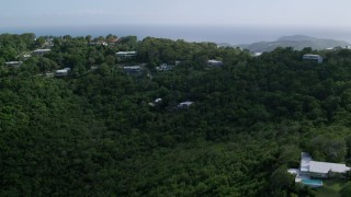 AX102_291 - 5k stock footage aerial video of Hilltop oceanfront homes reveal Caribbean blue waters, Northside, Charlotte Amalie