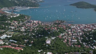 AX102_293 - 5k stock footage aerial video of a Coastal town along turquoise blue Caribbean waters, Charlotte Amalie, St Thomas