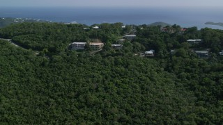 AX102_294 - 5k stock footage aerial video of Hilltop Caribbean homes among trees, Northside, St Thomas