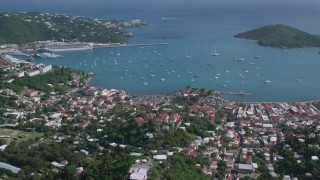 AX102_296 - 5K stock footage aerial video of a Coastal town along turquoise Caribbean waters, Charlotte Amalie, St Thomas