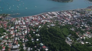 AX102_297 - 5k stock footage aerial video of a Coastal town along turquoise blue Caribbean waters, Charlotte Amalie, St Thomas