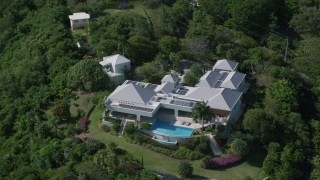 AX102_298 - 5k stock footage aerial video of a Mansion nestled among trees, Charlotte Amalie, St Thomas