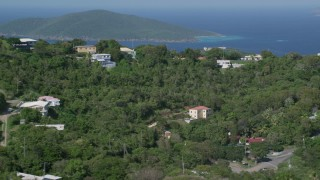 AX102_300 - 5k stock footage aerial video of Hilltop mansions looking out at Caribbean blue waters, Charlotte Amalie, St Thomas