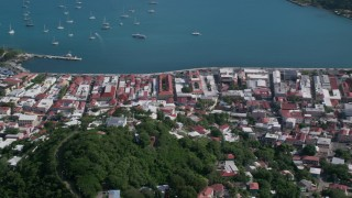AX102_303 - 5k stock footage aerial video of a Coastal town along sapphire blue Caribbean waters, Charlotte Amalie, St Thomas