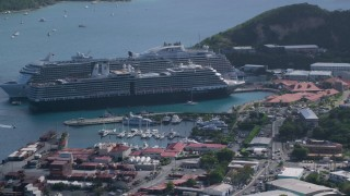 AX102_304 - 5k stock footage aerial video of a Docked cruise ships in turquoise blue Caribbean waters, Charlotte Amalie, St Thomas