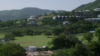 AX102_306 - 5K stock footage aerial video of University of the Virgin Islands set among tree covered hillside, St Thomas