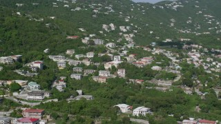 AX103_003 - 5k stock footage aerial video of Upscale hillside homes among trees, Charlotte Amalie, St Thomas