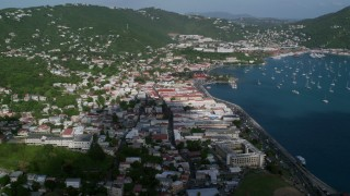 AX103_004 - 5K stock footage aerial video of a Coastal town along Caribbean blue waters, Charlotte Amalie, St Thomas