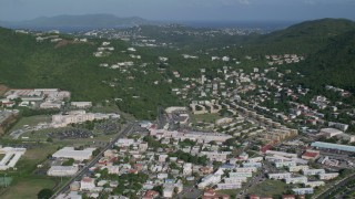 AX103_006 - 5K stock footage aerial video of Hillside homes among trees near the coast, Charlotte Amalie, St Thomas