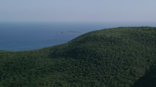 AX103_010 - 5k stock footage aerial video of Tree covered hills above blue Caribbean waters, Southside, St Thomas