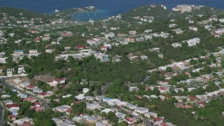 AX103_011 - 5k stock footage aerial video of Coastal homes among trees along Caribbean blue waters, East End, St Thomas