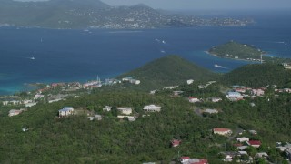 AX103_013 - 5k stock footage aerial video Caribbean resorts along sapphire blue waters, East End, St Thomas