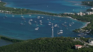 AX103_014 - 5k stock footage aerial video of Sailboats in Caribbean blue waters, Muller Bay, St Thomas