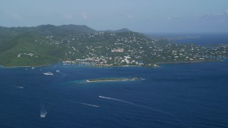 AX103_016 - 5k stock footage aerial video of a Coastal town on a hillside and blue Caribbean waters, Cruz Bay, St John
