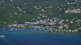 AX103_017 - 5k stock footage aerial video of a Coastal town and hillside homes along Caribbean blue waters, Cruz Bay, St John