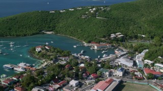 AX103_021 - 5k stock footage aerial video of a Harbor with boats in turquoise blue Caribbean waters, Cruz Bay, St John