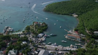 AX103_022 - 5k stock footage aerial video Sun reflecting on turquoise Caribbean waters in the harbor, Cruz Bay, St John