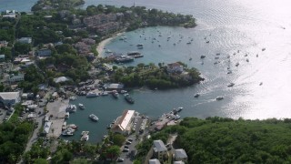 AX103_023 - 5k stock footage aerial video of a Resort along the Caribbean blue harbor, Cruz Bay, St John