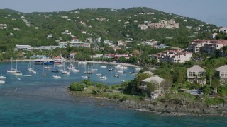 AX103_030 - 5k stock footage aerial video of the Turquoise blue Caribbean waters in the harbor with boats, Cruz Bay, St John