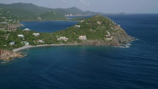 AX103_035 - 5k stock footage aerial video of Oceanfront homes and hillside mansions along sapphire blue waters, Cruz Bay, St John