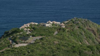 AX103_038 - 5k stock footage aerial video of Hilltop mansion with a sapphire blue ocean view, Cruz Bay, St John