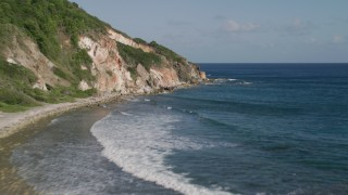 AX103_049 - 5k stock footage aerial video of Coastal cliffs along sapphire blue Caribbean waters, Central, St John