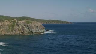 AX103_051 - 5k stock footage aerial video of Cliffs along Caribbean blue waters of Great Lameshur Bay, St John