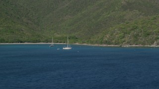 AX103_052 - 5k stock footage aerial video of Sailboats in the Caribbean blue waters of Great Lameshur Bay, St John