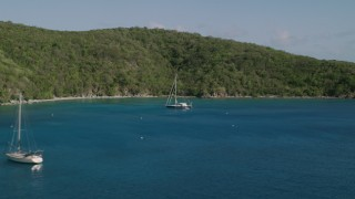 AX103_055 - 5k stock footage aerial video of Sailboats its the blue waters of Great Lameshur Bay, St John