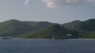 AX103_058 - 5k stock footage aerial video of Hillside mansions along Caribbean blue waters, Cruz Bay, St John