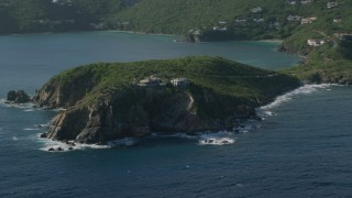 AX103_059 - 5k stock footage aerial video of cliff top mansion along Caribbean blue waters, Cruz Bay, St John