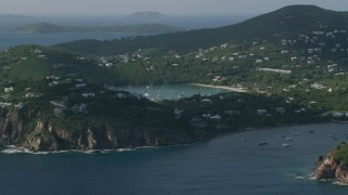AX103_061 - 5k stock footage aerial video of a Hill top and cliff top mansions with Caribbean blue ocean views, Cruz Bay, St John