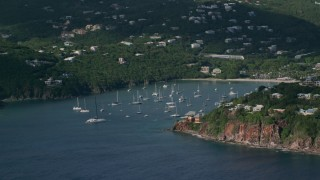 AX103_062 - 5k stock footage aerial video of Hillside Caribbean mansions with harbor and ocean views, Cruz Bay, St John