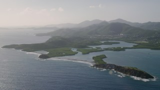 AX103_064 - 5k stock footage aerial video of Tiny islands in sapphire blue Caribbean waters off the coast, East End, St Thomas