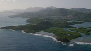 AX103_065 - 5k stock footage aerial video of Tiny islands in sapphire blue Caribbean waters along the shores, East End, St Thomas