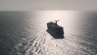 AX103_069 - 5k stock footage aerial video of a Carnival cruise ship in Caribbean blue waters, St Thomas