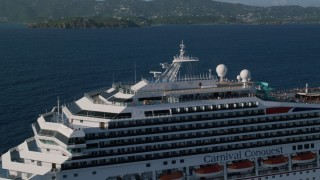 AX103_076 - 5k stock footage aerial video of a Pool area of carnival cruise ship in Caribbean blue waters,  St Thomas