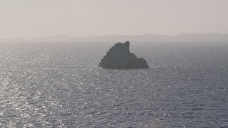 AX103_080 - 5k stock footage aerial video of a Rock formation in sparkling Caribbean waters, St Thomas