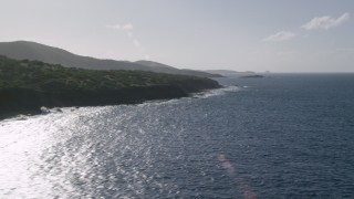 AX103_096 - 5k stock footage aerial video of the Island coast along sapphire blue Caribbean waters, Culebra, Puerto Rico