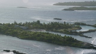 AX103_114 - 5k stock footage aerial video Tilt down on a small island's home in Caribbean waters, Puerto Rico