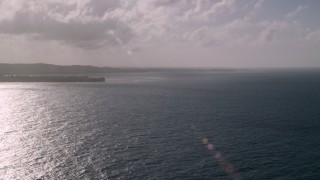 AX103_120 - 5k stock footage aerial video of Caribbean island coast and blue waters, Luquillo, Puerto Rico