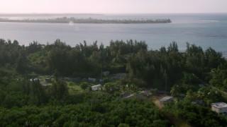 AX103_127 - 5k stock footage aerial video of Gran Melia Golf Resort with views of Caribbean blue waters, Puerto Rico