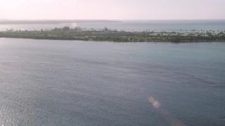 AX103_128 - 5k stock footage aerial video of Gran Melia Golf Resort with views of Caribbean blue waters, Puerto Rico