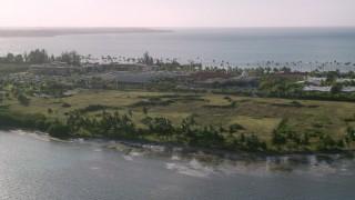 AX103_129 - 5k stock footage aerial video of Gran Melia Golf Resort with views of Caribbean blue waters, Puerto Rico
