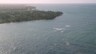 AX103_131 - 5k stock footage aerial video of Palm trees and beachfront homes, Loiza, Puerto Rico