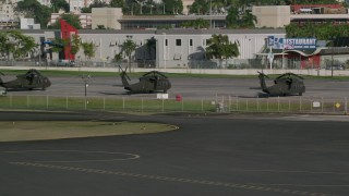 AX103_154 - 5k stock footage aerial video of Military helicopters at Isla Grande Airport, San Juan