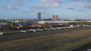 AX104_001 - 5k stock footage aerial video of Isla Grande Airport, Puerto Rico, sunset