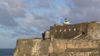 AX104_012 - 5k stock footage aerial video of Fort San Felipe del Morro, Old San Juan, sunset